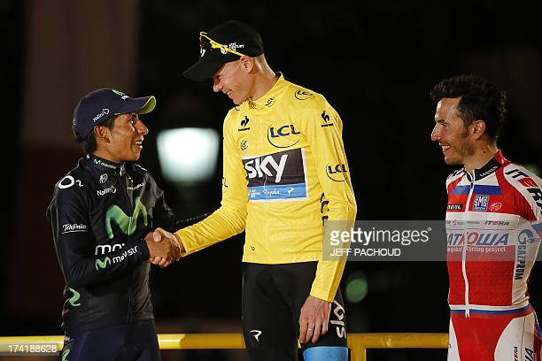 Tour de France 2013 winner Britain's Christopher Froome shakes hand with Secondplaced and best climber's polka dot jersey Colombia's Nairo Quintana...