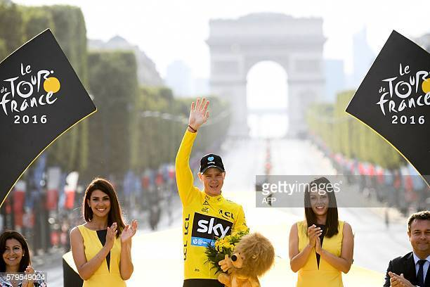 TOPSHOT Tour de France 2016's winner Great Britain's Christopher Froome celebrates his overall leader yellow jersey on the podium on the...