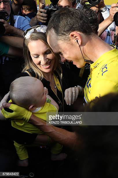 Tour de France 2016's winner Great Britain's Christopher Froome wearing the overall leader's yellow jersey, celebrates with his wife Michelle Cound...