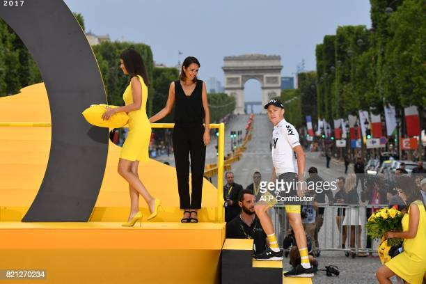 Tour de France 2017's winner Great Britain's Christopher Froome arrives on the podium to celebrate his overall leader yellow jersey at the end of the...