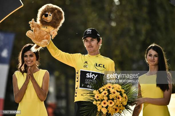Tour de France 2018 winner Great Britain's Geraint Thomas celebrates his overall leader yellow jersey on the podium after the 21st and last stage of...
