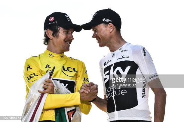 TOPSHOT Tour de France 2018 winner Great Britain's Geraint Thomas wearing the overall leader's yellow jersey shakes hands with thirdplaced Great...