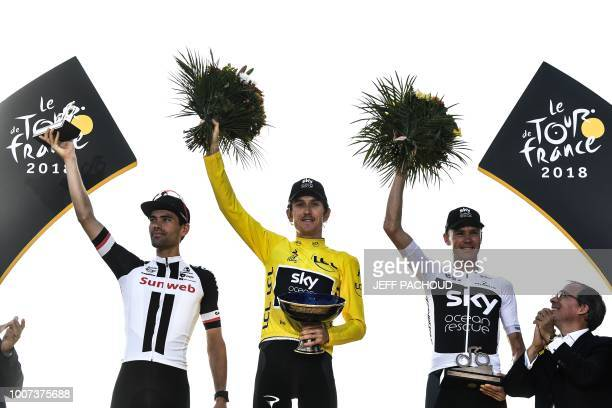 Tour de France 2018 winner Great Britain's Geraint Thomas wearing the overall leader's yellow jersey secondplaced Netherlands' Tom Dumoulin and...