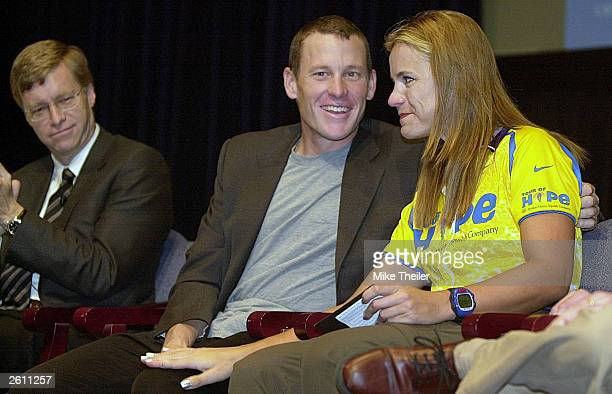 Tour de France Champion Lance Armstrong hugs Dr Milana Dolezal after her remarks at the National Institutes of Health October 17 2003 in Bethesda...