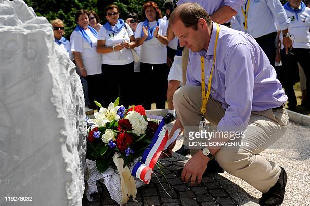 Tour de France director Christian Prudhomme lays down a bunch of flowers on a stela built in memory of Italian cyclist Fabio Casartelli in the Portet...