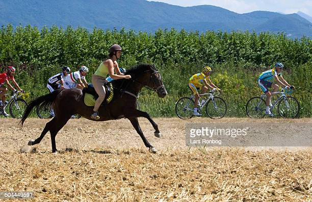 Tour de France Stage 17 Alberto Contador Team Astana in the leaders yellow jersey and a horse © Frontzonesport
