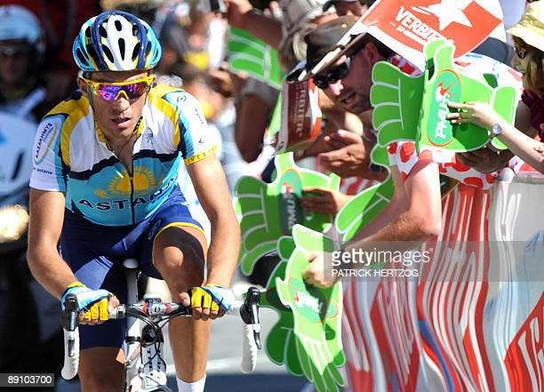Tour de France winner and Kazakh cycling team Astana 's leader Alberto Contador of Spain sprints on the finish line before winning on July 19 2009...