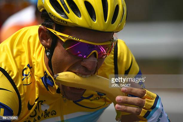 Tour de France winner and Kazakh cycling team Astana 's leader Alberto Contador of Spain bites a banana as he rides in the pack on July 21 2009...