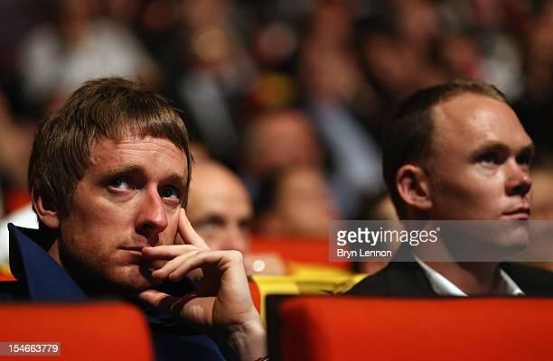 Tour de France winner Bradley Wiggins and Chris Froome watch the 2013 Tour de France Route Presentation at the Palais des Congres de Paris on October...