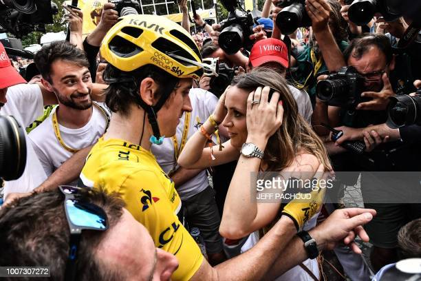 TOPSHOT Tour de France winner Great Britain's Geraint Thomas wearing the overall leader's yellow jersey celebrates with his wife SarahEllen after the...