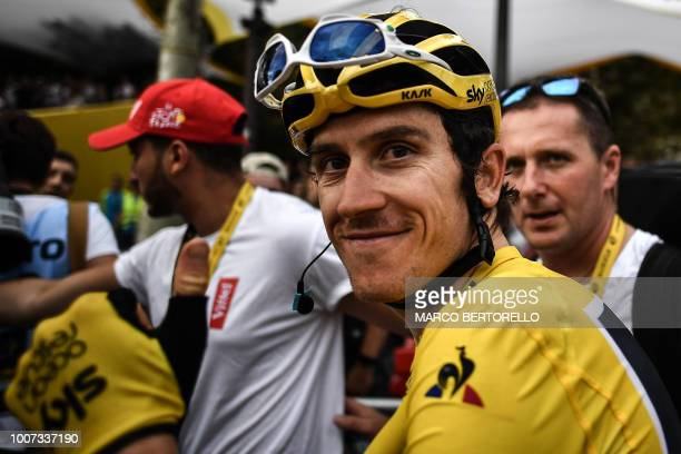 Tour de France winner Great Britain's Geraint Thomas wearing the overall leader's yellow jersey smiles after the 21st and last stage of the 105th...