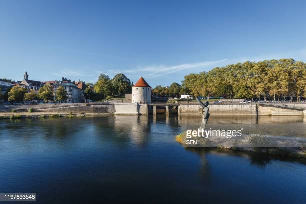 tour de la pelote, quai de strasbourg, an old french style fort and river in besancon, france - ブザンソン ストックフォトと画像