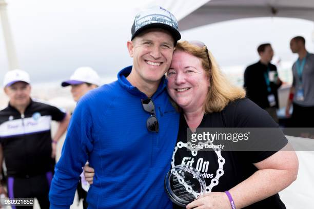 Tour de Pier Cofounder Keith Gregory and Betsy McLoughlin display her award at the 6th Annual Tour de Pier at Manhattan Beach Pier on May 20 2018 in...