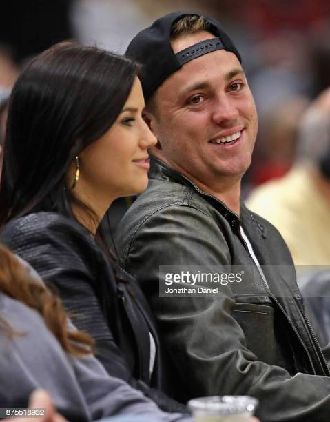 Tour golfer Justin Thomas and girlfriend Jillian Wisniewski sit courtside as the Chicago Bulls take on the Charlotte Hornets at the United Center on...