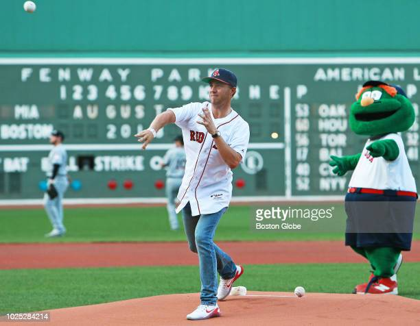 Tour golfer Justin Thomas throws out a ceremonial first pitch before the start of the game The Boston Red Sox host the Miami Marlins in a regular...