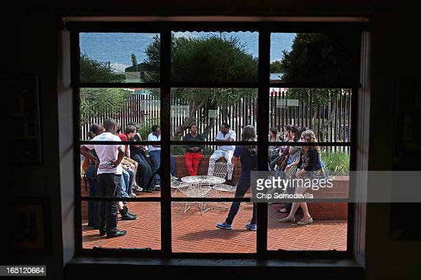 A tour group hears from a guide while visiting the Mandela House and Museum on historic Vilakazi Street in Soweto March 31 2013 in Johannesburg South...