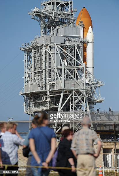 A tour group looks at the space shuttle Discovery on Pad 39A on November 1 2010 at Kennedy Space Center in Florida Discovery is scheduled for a...