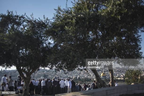 A tour group looks out onto the Dome of The Rock on the Temple Mount from Mount of Olives in East Jerusalem Israel on Saturday Dec 16 2017 The United...