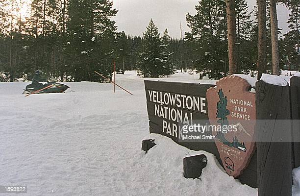 A tour group on snowmobiles rides past the entrance to Yellowstone National Park February10 2001 The National Park Service acknowledges that the ban...