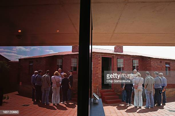 A tour group prepares to endter the Mandela House and Museum on historic Vilakazi Street in Soweto March 31 2013 in Johannesburg South Africa From...