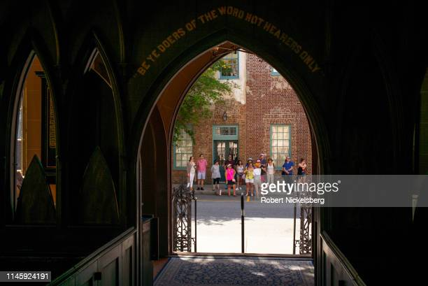 A tour group stands outside the 1844 French Huguenot Church in Charleston South Carolina on April 23 2019 Facing persecution in predominantlyCatholic...