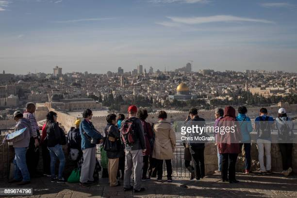 A tour groups looks out over the AlAqsa Mosque in the Old City on December 10 2017 in Jerusalem Israel In an already divided city US President Donald...