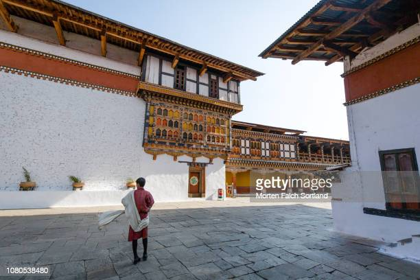 a tour guide at a temple in paro, bhutan - ブータン ストックフォトと画像