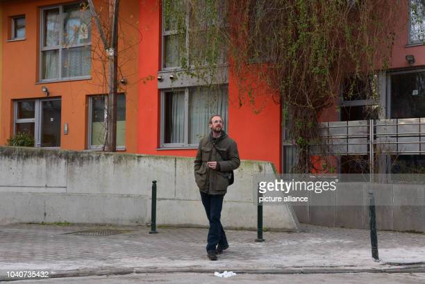 Tour guide Bert de Bisschop stands in front social housing in the district of Molenbeek in Brussels Belgium 28 January 2016 He regularly guides...