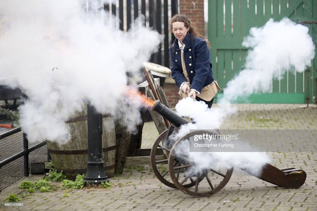 A tour guide demonstrates a cannon firing next to HMS Trincomalee at Hartlepool Historic Quay at the National Museum of The Royal Navy on October 11, 2017 in Hartlepool, England. HMS Trincomalee, celebrates it's 200th aniversary tomorrow and is the oldest British fighting ship still afloat. HMS Trincomalee was built in Bombay in 1817 and was one of the last ships commissioned to be built by Nelson. The ship was named Trincomalee after the 1782 Battle of Trincomalee in Ceylon