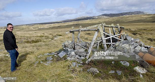 Tour guide Derek Pettersson shows the wreckage of an Argentine trench used during the 1982 conflict near Port Stanley in the Falkland Islands on...