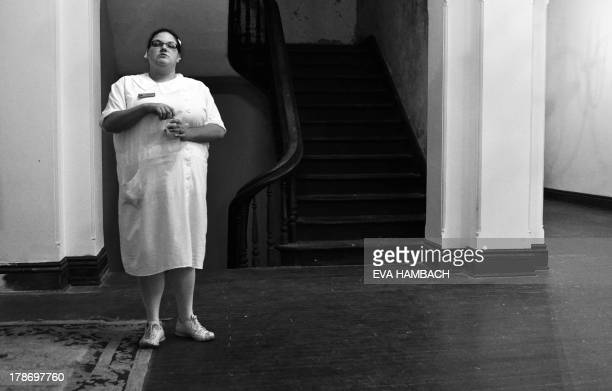 Tour guide dressed as a nurse stands in the first-floor lobby in the main building of the Trans-Allegheny Lunatic Asylum in Weston, West Virginia on...