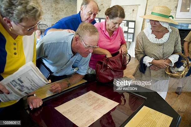 A tour guide dressed in colonial costume shows General George Washington's resignation letter during a tour of the State House in Annapolis MD August...