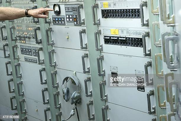 A tour guide explains electronics inside a Titan II silo's control center at the Titan Missile Museum on May 12 2015 in Green Valley Arizona The...