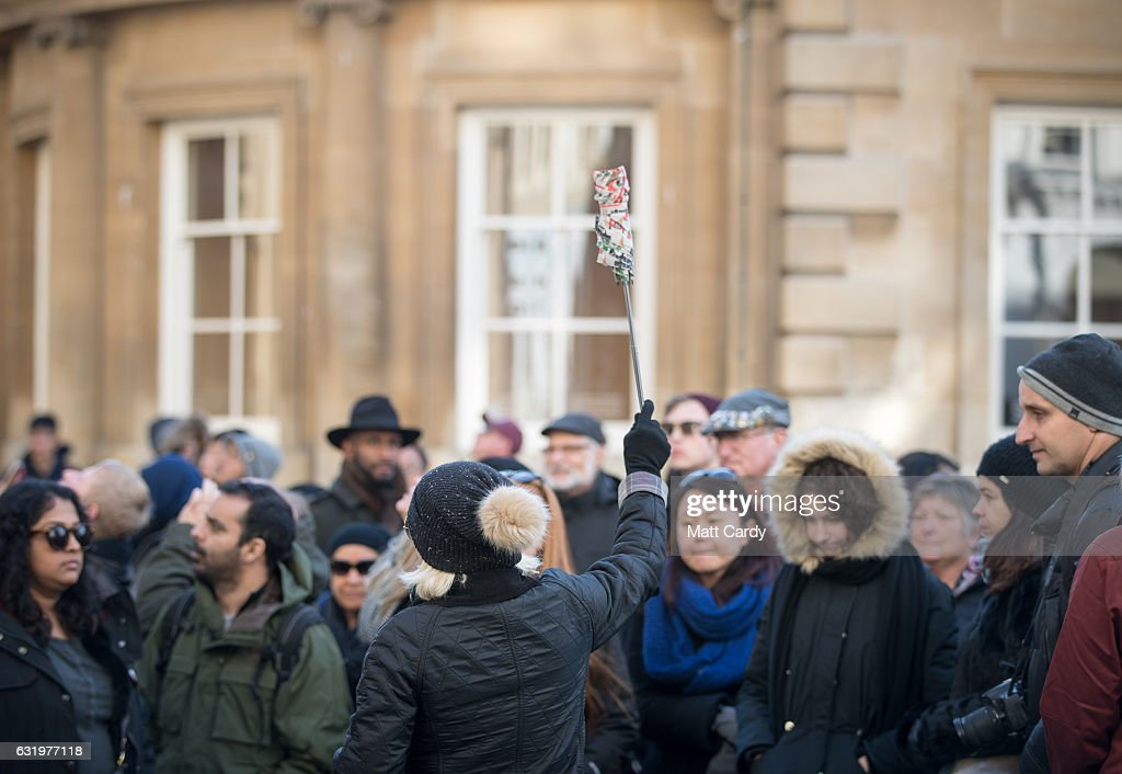 A tour guide gathers visitors to the historic city of Bath in front of the Bath Abbey on January 18, 2017 in Bath, England. Plans for a possible overnight tourist bed tax are currently being discussed by Bath and North East Somerset council as one possible way of helping to bridge the £37million of cuts currently required by 2020. The city, a UNESCO World Heritage site, is famed for its Roman remains and Georgian architecture and attracts visitors from across the world.