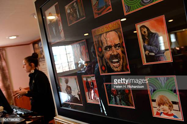 Tour guide Jofia Ross left talks to visitors next to a display of movie memorabilia from the popular movie The Shining at the Stanley Hotel on...