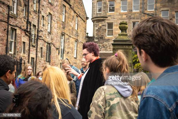 A tour guide leads a group of fans on a Harry Potter tour in Edinburgh
