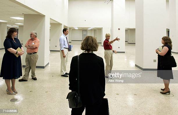 Tour guide Mia Decker introduces the Exhibit Hall of a former government relocation facility also know as the bunker to the members of the press...