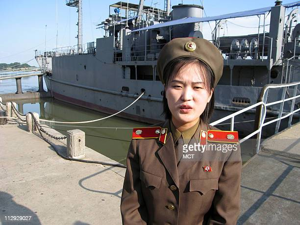 A tour guide prepares to taken visitors aboard the spy ship USS Pueblo which was seized by North Korea in 1968 and remains a trophy for the country