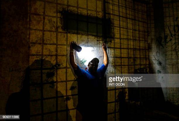 TOPSHOT A tour guide shows tourists how prisioners were treated at Fortaleza El Coyotepe in Masaya Nicaragua on January 16 2018 The fortress is an...