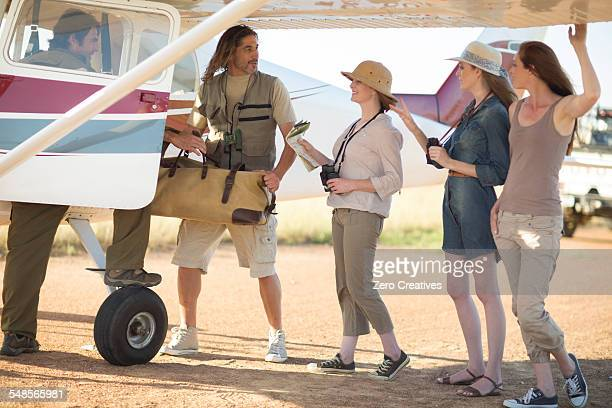 Tour guide with tourists beside plane, Wellington, Western Cape, South Africa