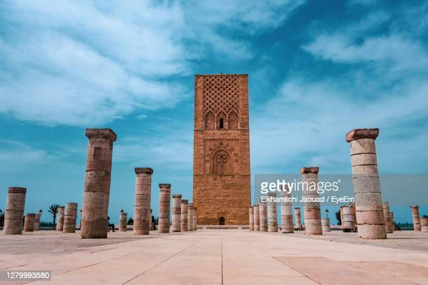 tour hassan tower in the square with stone columns. important historical  in rabat, morocco - rabat morocco stock pictures, royalty-free photos & images