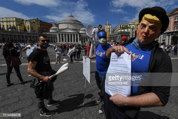 Tour operators and entertainers take part in a demonstration in Plebiscito square to protest over the economic crisis which has been exacerbated by...