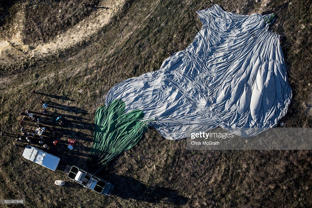 Tour operators pack up a hot air balloon after a tourist flight on April 17, 2016 in Nevsehir, Turkey. Cappadocia, a historical region in Central Anatolia dating back to 3000 B.C is one of the most famous tourist sites in Turkey. Listed as a World Heritage Site in 1985, and known for its unique volcanic landscape, fairy chimneys, large network of underground dwellings and some of the best hot air ballooning in the world, Cappadocia is preparing for peak tourist season to begin in the first week of May. Despite Turkey's tourism downturn, due to the recent terrorist attacks, internal instability and tension with Russia, local vendors expect tourist numbers to be stable mainly due to the unique activities on offer and unlike other tourist areas in Turkey such as Antalya, which is popular with Russian tourists, Cappadocia caters to the huge Asian tourist market.