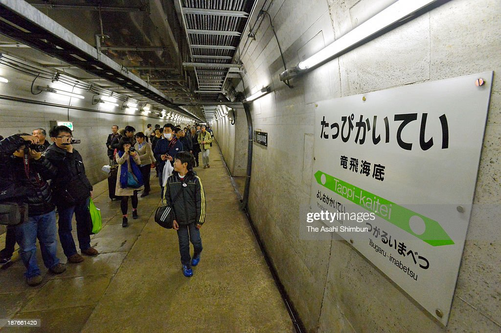 Tour participants walk a tunnel leading to the 'Tappi Kaitei (sea bottom)' Station on November 10, 2013 in Sotogahama, Aomori, Japan. The station, located 135 metres under the sea level, was constructed as an emergency exit in 1988 along with the opening of Seikan tunnel, which connect Hokkaido and Japan's mainland. The station will be closed as a part of preparation for extending the Shinkansen bullet train to Hokkaido.