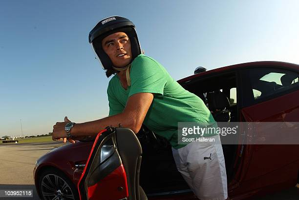 Tour player Rickie Fowler poses for a photo after test driving BMW cars at the Autobahn Country Club Racetrack on September 9 2010 in Joliet Illinois