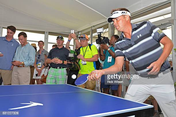 Tour pro Jeff Overton plays ping pong inside the Grey Goose The Oasis Lounge at The Players Championship on May 11 2016 in Ponte Vedra Florida