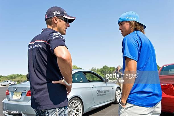 Tour Professional Rickie Fowler and BMW American LeMans Series race driver Joey Hand at Autobahn Racetrack to raise money to benefit the Evans...