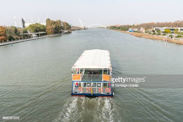 Tourboat cruising the Guadalquivir river in Seville