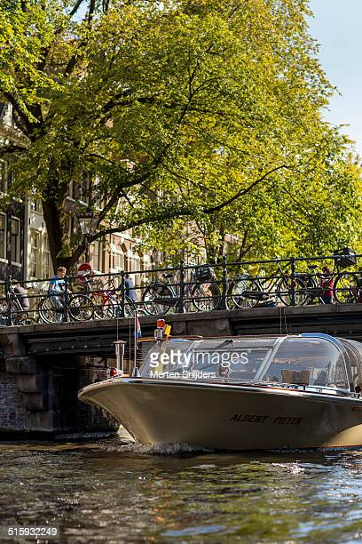 Tourboat under bridge along Singel gracht