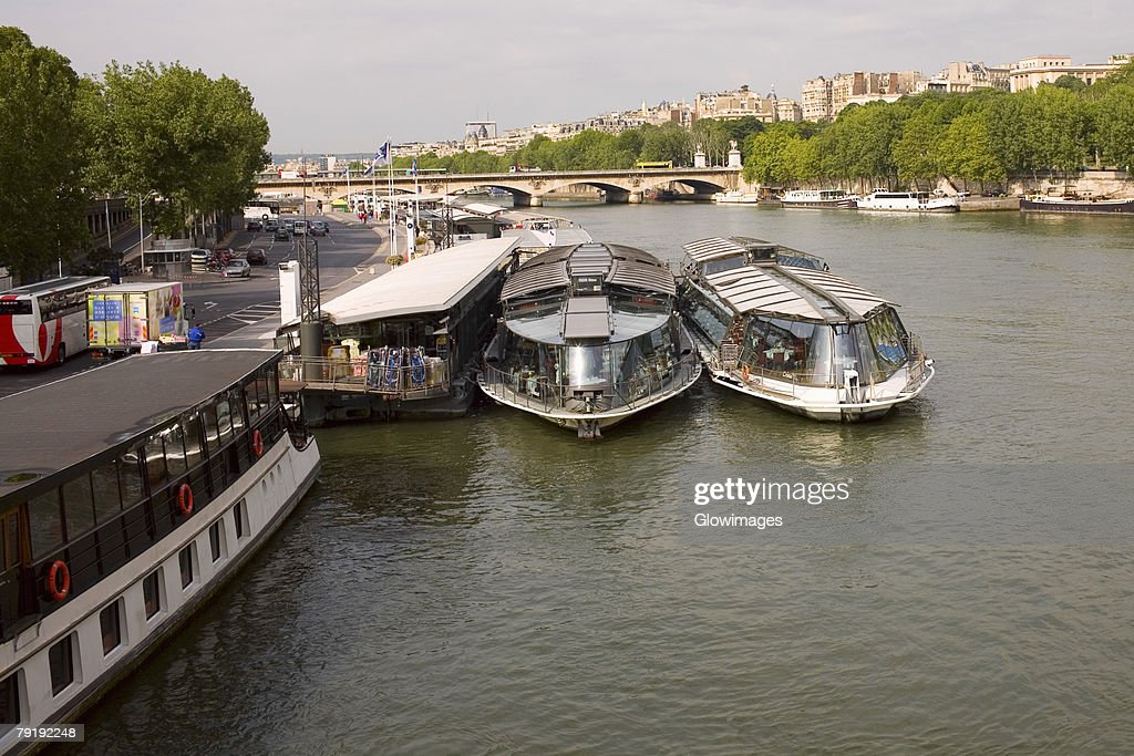 Tourboats docked at a port, Seine River, Paris, France : Stock Photo
